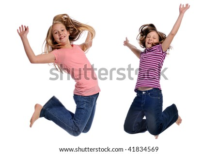 Girls jumping showing happiness isolated on a white background - stock photo
