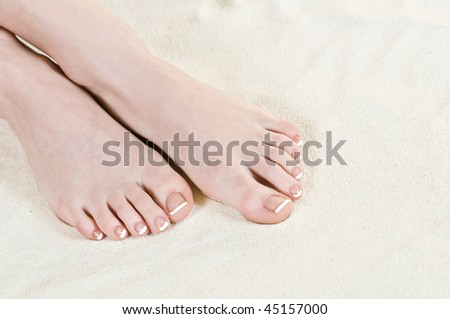 girls legs on beach sand