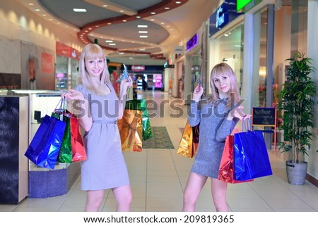 Girls Make A Shopping At The Mall