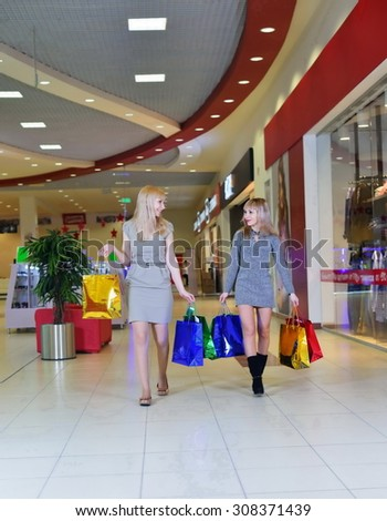 Girls make a shopping  at the mall - stock photo