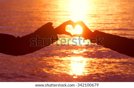 girls making heart with hand - stock photo