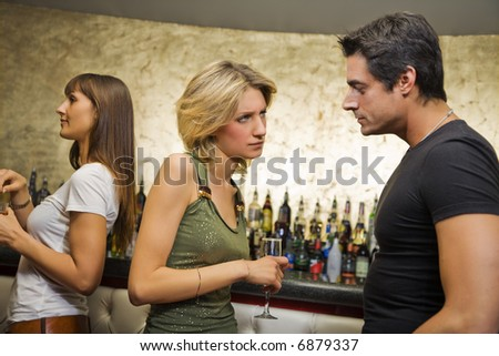 girls night out: guy breaking up with his girlfriend - stock photo
