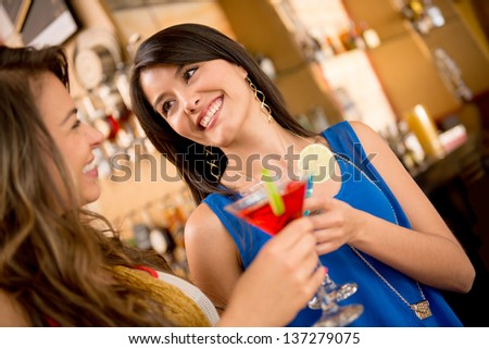 Girls night out having drinks and talking - stock photo