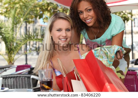 girls on a coffee room's terrace - stock photo