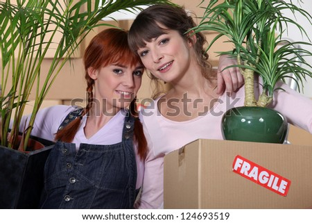 Girls on moving day - stock photo