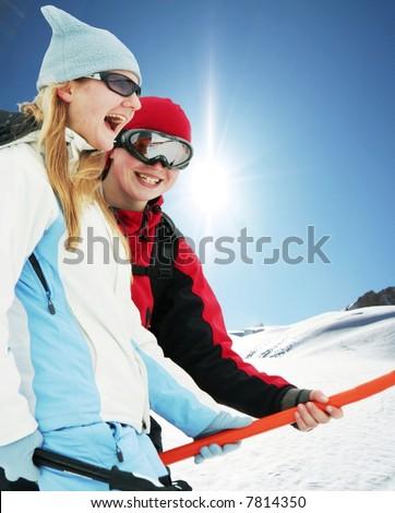 Girls on skies resort - stock photo