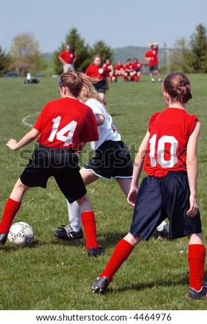Girls on Soccer Field Fighting for Ball - stock photo