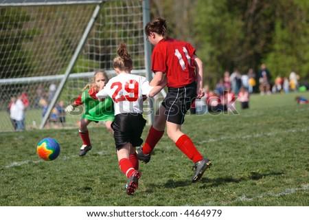 Girls on Soccer Field Fighting for Ball 2 - stock photo