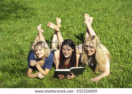 Girls on the nature of reading a book - stock photo