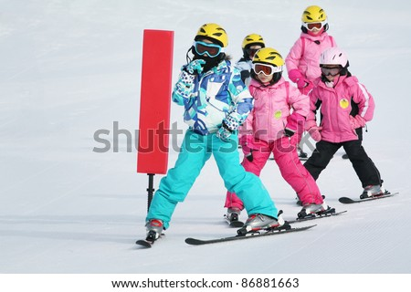 girls on the ski - stock photo