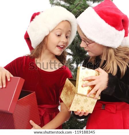 Girls opening presents - stock photo