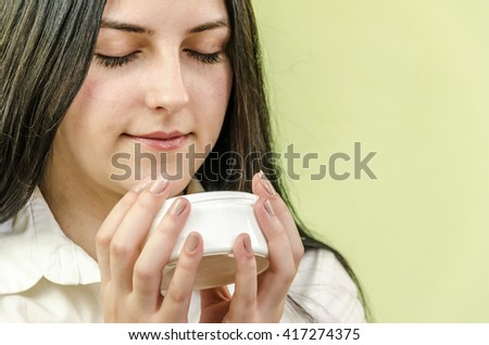 Girls or teenage girls looking and smelling cream for face and skin
