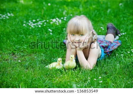Girls play with duck - stock photo