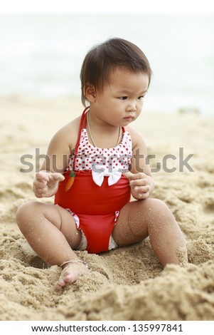 Girls playing a beach holiday in the summer - stock photo
