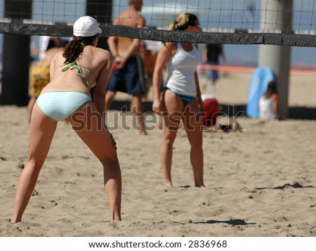 Girls Playing Beach Volleyball - stock photo