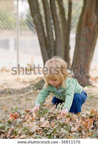 Girls Playing in Fall Leaves