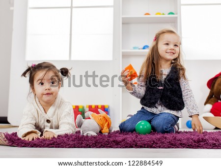Girls playing in the room