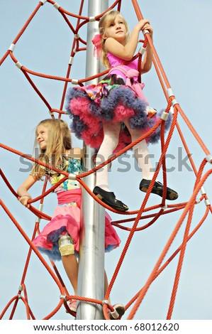 Girls playing on the playground - stock photo