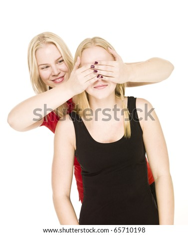 Girls playing Peek-a-boo isolated on white background - stock photo