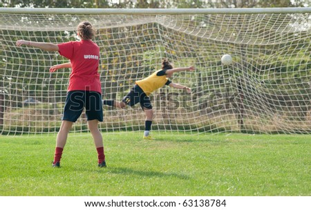 Girls playing soccer - stock photo