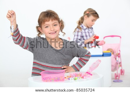 Girls playing with their toys - stock photo