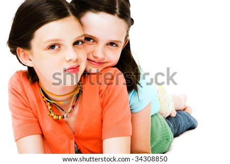 Girls posing and smiling together isolated over white - stock photo
