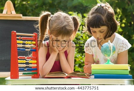 girls preparing boring lessons in nature and tired