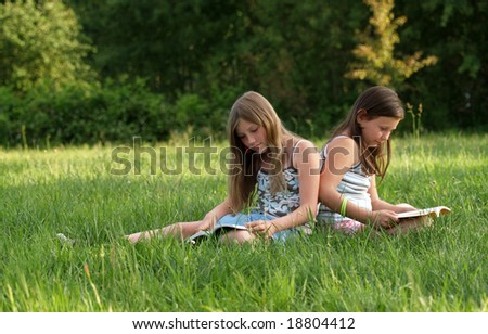 Girls reading a book