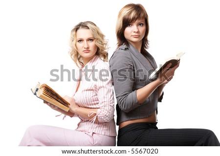 Girls reading the books on white background - stock photo