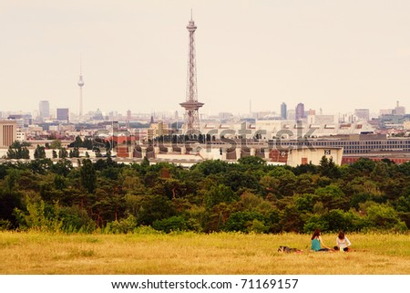 Girls relaxing in backround of berlin city skyline - stock photo