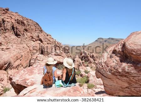 Girls relaxing on hiking trip, Nevada USA. - stock photo