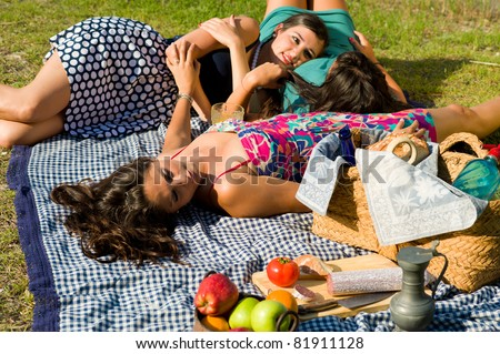 Girls resting after an ejoyable picnic outdoors