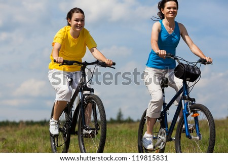 Girls riding bikes - stock photo