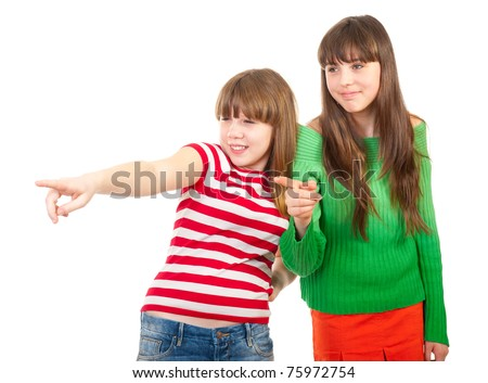 Girls show at someone and giggle isolated - stock photo
