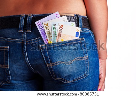 Girls Shows her money inside her Jeans Back Pocket - stock photo