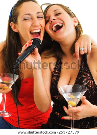 Girls singing on white background, with martini glasses