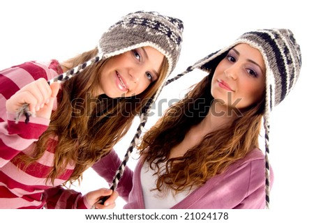 girls stretching her cap's laces with white background - stock photo