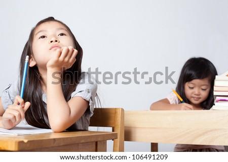 Girls studying and thinking - stock photo