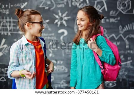 Girls talking - stock photo