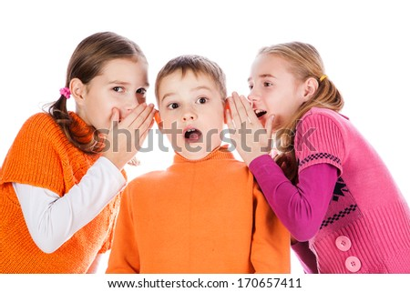 Girls tells a secret to the boyfriend isolated over white background - stock photo