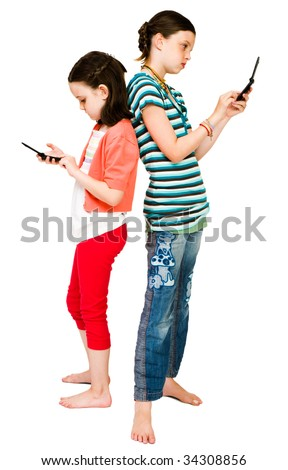 Girls text messaging on mobile phones isolated over white - stock photo