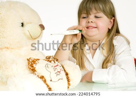 girls treated her bear/girls treated her bear - stock photo