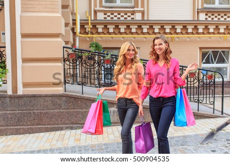 girls walking after shopping