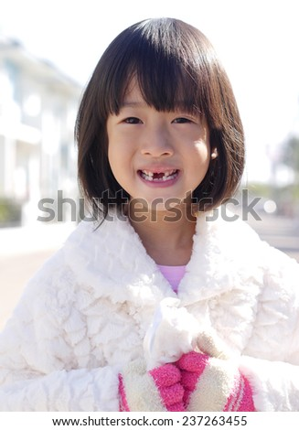 Girls wear sweaters in the winter. - stock photo
