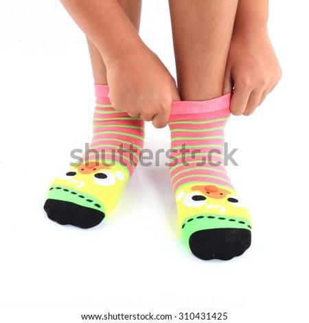 Girls wearing striped socks colorful beauty. - stock photo