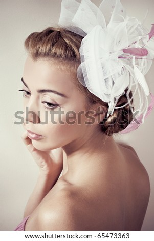 Girls with a fancy hat - stock photo
