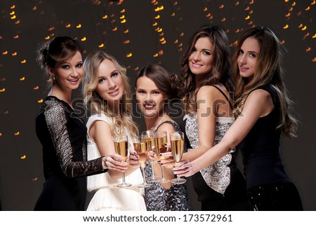 Girls with a glass of champagne have new year party