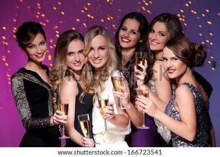 Girls with a glass of champagne meet new year - stock photo
