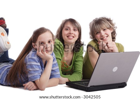Girls with a laptop. Shot in studio.