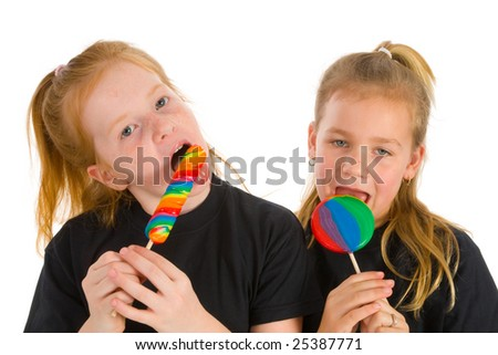 Girls with a lolly in many colors - stock photo